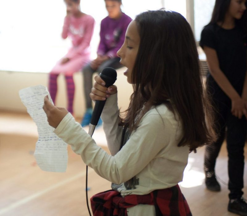 Dita (11), performing a song during one of the activities in Adice